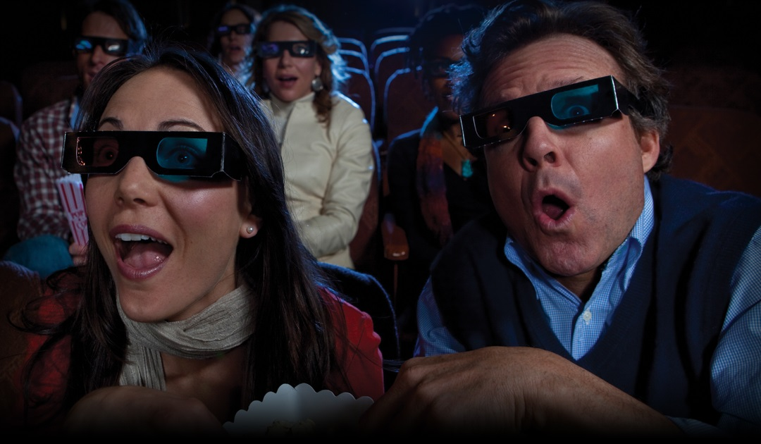 Couple at movie theater wearing 3D glasses