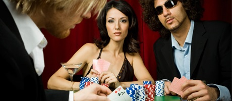 Well dressed man and Woman at poker table