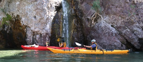 Kyaking near a small waterfall on a half day trip